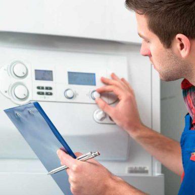 Boiler engineer servicing a boiler