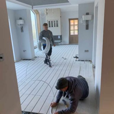 Underfloor heating being installed in a kitchen