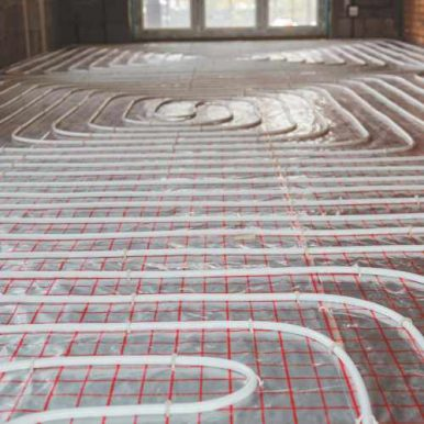 Laying underfloor heating in a bathroom
